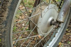 Front wheel hub with spoke of vintage Japanese motorcycle. Dirty front wheel hub with spoke of vintage Japanese motorcycle royalty free stock images