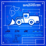 Front wheel loader icon like blueprint drawing. Front wheel loader symbol stylized blueprint technical drawing. White symbol on blue grid background Royalty Free Stock Photography