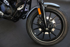 The front wheel of a motorcycle. Stock Image