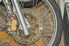 Front wheel motorcycle. Near path way Stock Image
