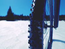 Front wheel of mountain bike blocked in snow. Snow riding. Royalty Free Stock Photography