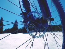 Front wheel of mountain bike blocked in snow. Snow riding. Royalty Free Stock Photo