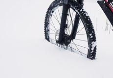 The front wheel of mountain bike stay in powder snow. Lost path Stock Photo