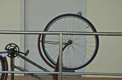 Front wheel with mudguard of a bicycle. With building wall Stock Photo