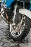 The front wheel and tire of a motorcycle Stock Photography