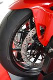 Front wheel and twin brake disc of racing motorcycle on a stands case royalty free stock images