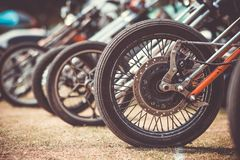 Front wheels of motorcycles exposed in a parking lot royalty free stock image