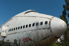 Front of white airplane wreckage. Taken on a sunny day, useful for plane safety, pilot, flights, air craft, aero space industry, travel, holiday, insurance Stock Image
