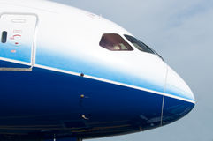 Front of wide-body airplane. Front profile and cockpit windows of wide-body airplane Royalty Free Stock Photos