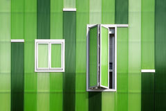 Front windows of a green building Royalty Free Stock Images