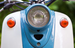 Front wing and headlight of blue retro scooter.  Royalty Free Stock Photography
