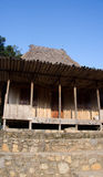 Front of wooden house in Bena a traditional village with grass huts of the Ngada people in Flores. Royalty Free Stock Images