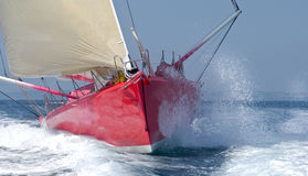 Front yacht at regatta. With waves in summer Stock Photos
