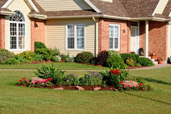 Front Yard. Front entrance of a new home landscaped with flowers Royalty Free Stock Images