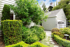 Front yard green garden with walkway. Small front yard green garden with trimmed bushes and walkway Stock Images