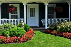 Front yard of a house. Landscaped front yard of a house with flowers and green lawn Stock Image