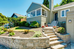 Front yard landscape with stone trim. House exterior Stock Image