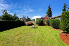 Front yard with sitting area and trimmed hedges Royalty Free Stock Image