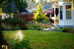 Front yard. A well manicured front yard gets it's daily watering Royalty Free Stock Photos