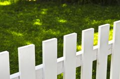 Front yard with white fence Royalty Free Stock Photography