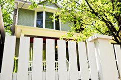 Front yard with white fence Stock Image