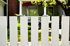 Front yard with white fence Stock Images