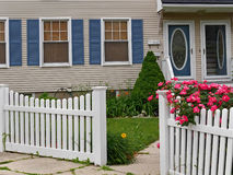 Front yard with white picket fence Royalty Free Stock Photos