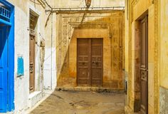 Old mansions in Sfax, Tunisia. The frontage of the medieval mansion is decorated with fine carved pattern on stone wall and wooden door, Sfax, Tunisia Royalty Free Stock Images