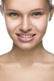 Frontal closeup clean beauty portrait of a blond. Frontal vertical closeup clean beauty portrait of a blond beautyful smiling woman Stock Photography