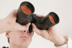 Man with binoculars near Royalty Free Stock Images