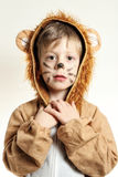 Frontal portrait of the boy dressed for lion with whiskers Stock Photo