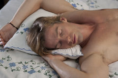 Frontal Portrait of Man Sleeping in Bed Royalty Free Stock Photography