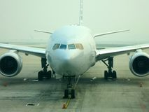 Frontal View of Airplane. A frontal view of a jumbo jet stock photo