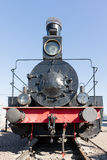 Frontal view of an ancient steam locomotive against the backgrou Royalty Free Stock Image