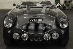 Frontal view of a  Austin Healey 100F old car. Switzerland Royalty Free Stock Photos