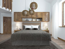 Frontal view of the bed in the bedroom in the loft. Stock Photos