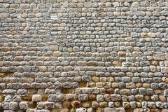 Frontal view of a broken textured ancient stone wall Stock Photography