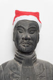 Frontal view of Chinese terracotta warrior statue wearing a santa hat Royalty Free Stock Photos