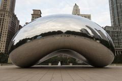 Frontal view of the Cloud Gate Anish Kapoor sculpture in the early morning with wedding couple royalty free stock photo