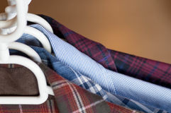 Frontal view of collars of shirts Stock Image