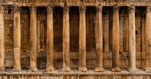 Frontal view of a colonnade - Row of columns of an ancient Roman temple ruin Bacchus temple in Baalbek royalty free stock photography
