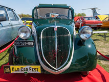 Frontal view of the famous Fiat 500 Topolino. Kyiv, Ukraine - April 26, 2015: The festival Old Car Fest 2015, showed an elegant vintage Fiat 500 car, commonly Stock Image