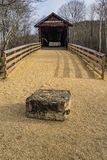 A Frontal View of the Humpback Covered Bridge, Virginia, USA. A frontal view with a large stone of the Humpback Covered Bridge located in the Allegheny Mountains stock images