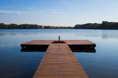 Frontal view of pier in the river. Perspective Frontal view of pier in the river Royalty Free Stock Image