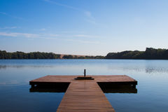 Frontal view of pier in the river. Perspective Frontal view of pier in the river Stock Photo