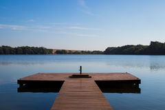 Frontal view of pier in the river. Perspective Frontal view of pier in the river Stock Photography