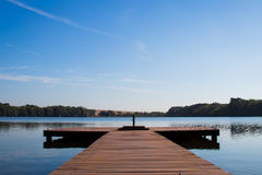 Frontal view of pier in the river. Perspective Frontal view of pier in the river Stock Photos