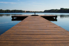 Frontal view of pier in the river. Perspective Frontal view of pier in the river Stock Image