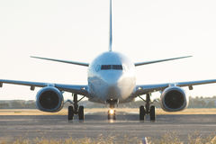 Frontal view of plane crossing tarmac Royalty Free Stock Image