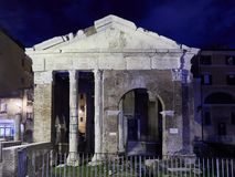 Portico d`Ottavia at night. Frontal view of Portico d`Ottavia at night. Ancient structure in Rome, Italy. The colonnaded walks of the portico enclosed the royalty free stock photos